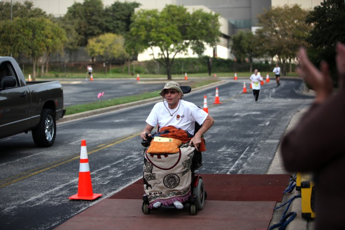Dan Keitz crossing finish line in his wheelchair
