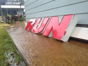 "Red letters in a puddle spell out ""run."""