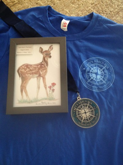 Race shirt, medal, and orignal artwork award for Capt'n Karl's Trail Series