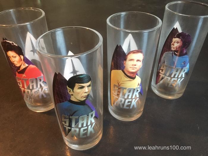 Four Star Trek glasses featuring Uhuru, Spock, Kirk, and Dr. McCoy.