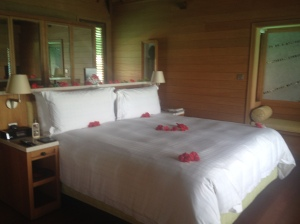 Bed at resort with red flowers