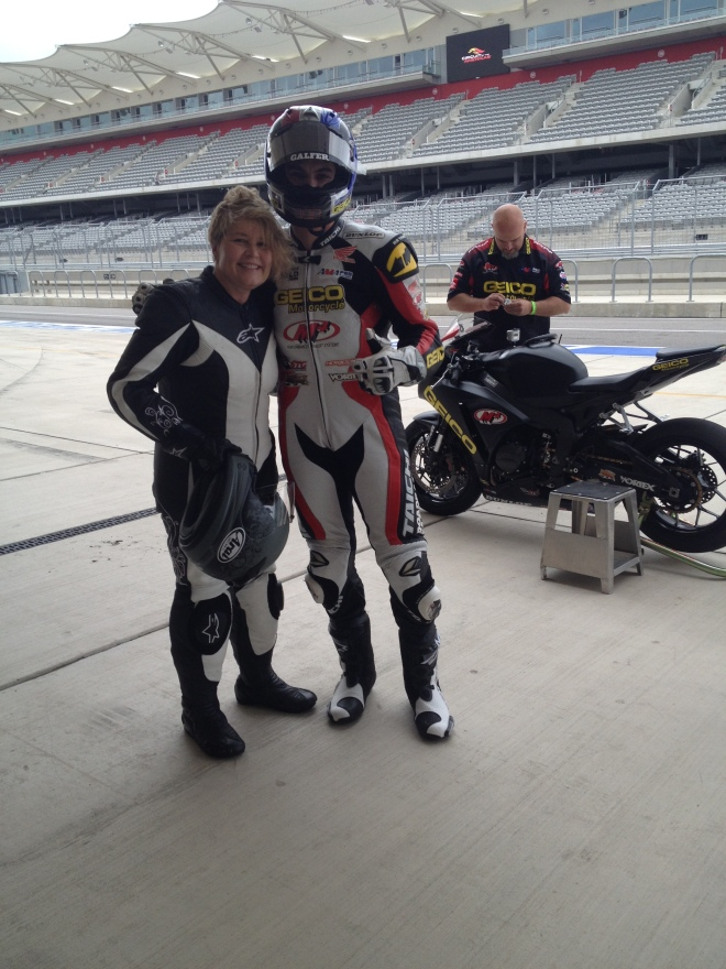 Leah Nyfeler, Chris Ulrich in front of two-seater Honda Superbike at COTA