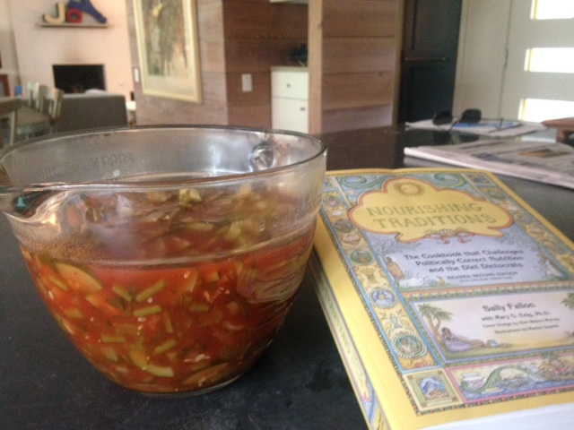 Container of soup with cookbook