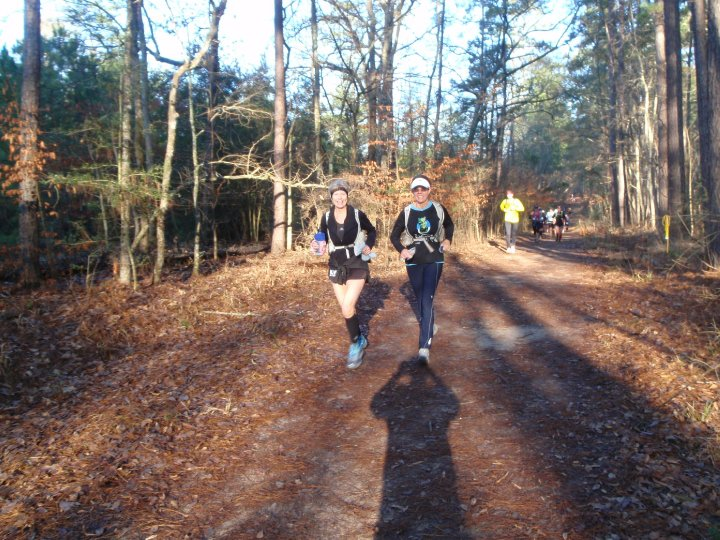 Two women running on a trail in Huntsville State Park