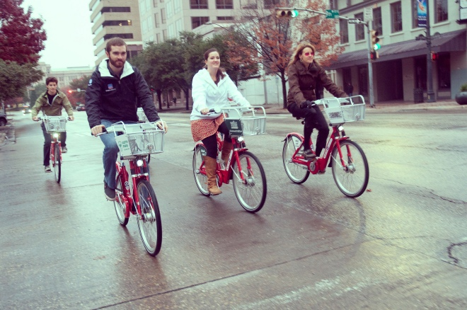 four casual cyclists use Austin's B-cycles downtown