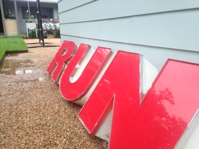 Red RUN sign in a puddle