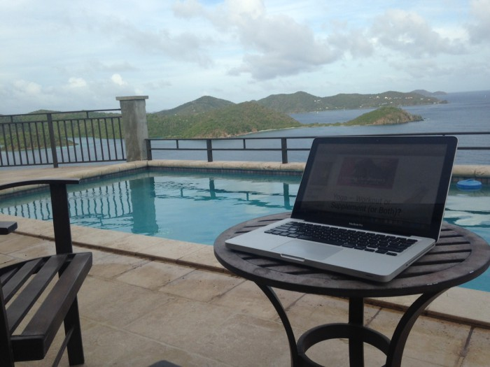 Laptop in front of pool and the islands of St. John USVI