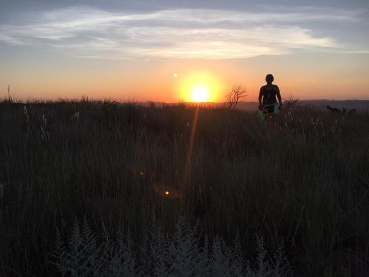 Runner silhouetted at sunrise in Davis Mountain State Park.
