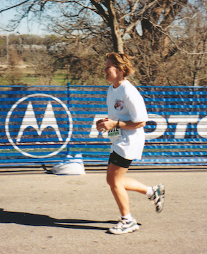 Runner finishing Motorola Marathon in Austin.