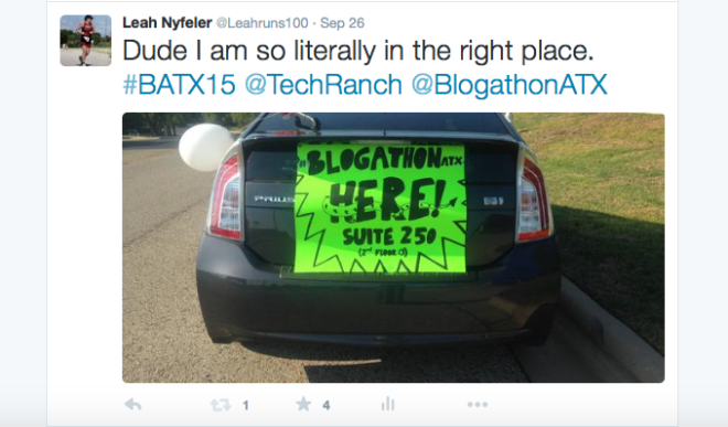 Car with sign for BlogathonATX in Twitter post.