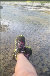 Feet in stream with running shoes