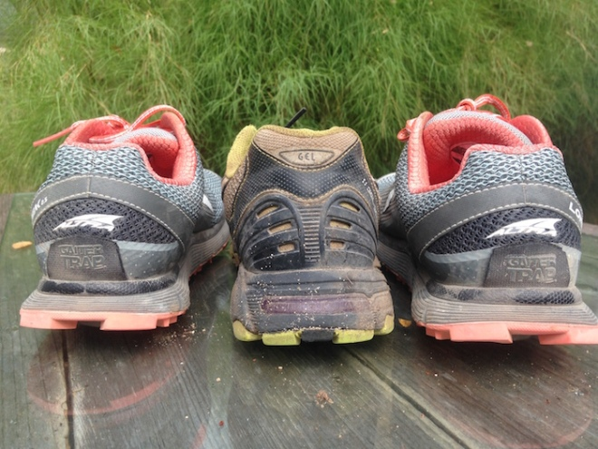 Take a look at how the heel height of these running shoes differ. Altras (outside),  old Asic(center).