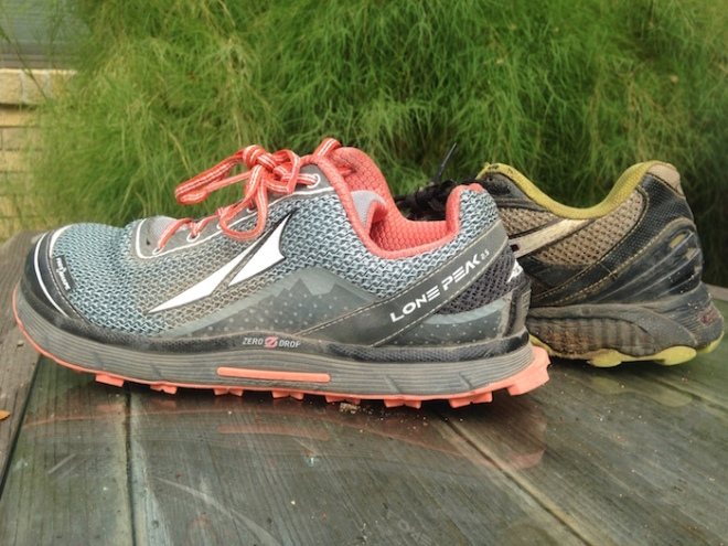Two different trail running shoes compared side by side.