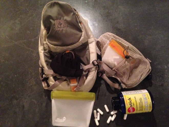 Nathan backpack shown with resealable bags and Salt Sticks.