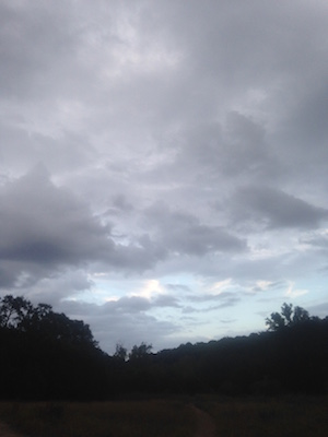 Photo of storm clouds at Barton Creek greenbelt at dusk.