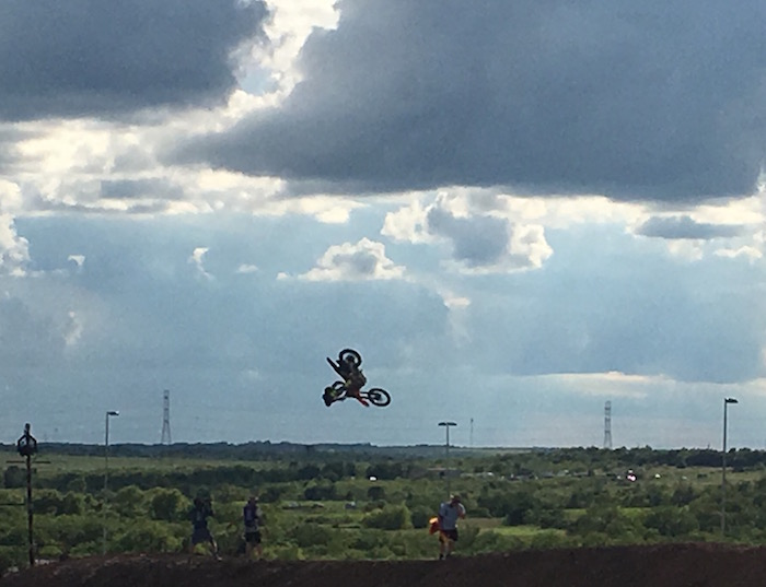 BMX rider Tom Pages silhouetted against at stormy sky at X Games Austin 2016.