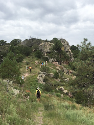 Hikers on Mt. Livermore trail in Davis Mountains Preserve.