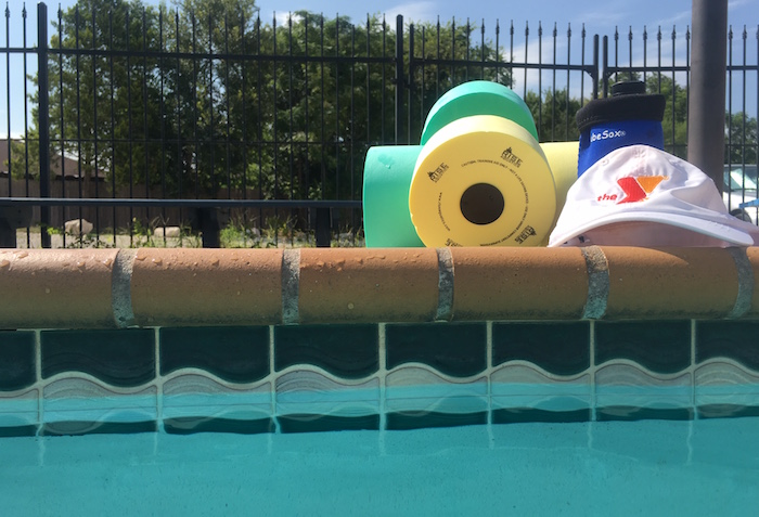Water weights, YMCA cap, and water bottle at the pool.