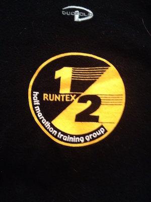 Logo from RunTex Half Marathon class shirt.