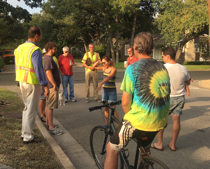 City employees in neon traffic vests talk with Cherrywood neighbors about a sidewalk project on Lafayette Ave.