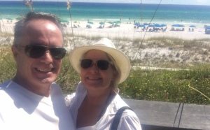 James and Leah Nyfeler on boardwalk at Miramar Beach in Florida.