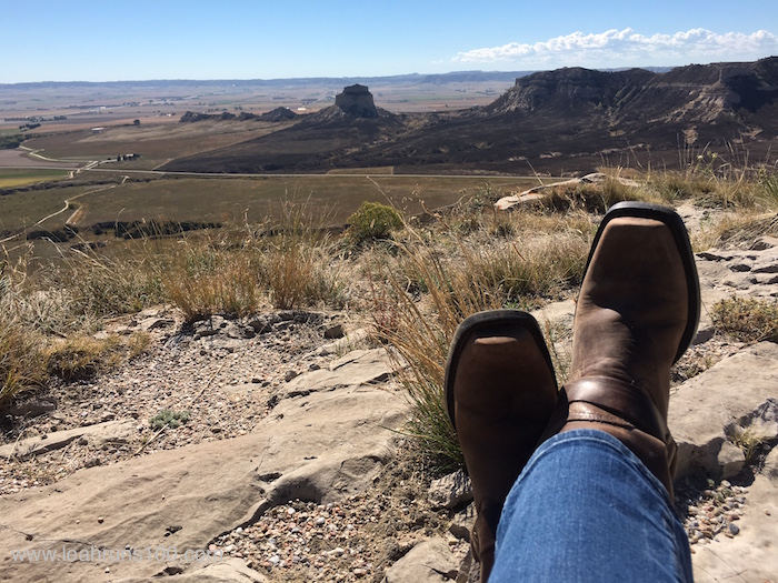Boots in foreground of horizon from atop Scotts Bluff Monument in Nebraska.