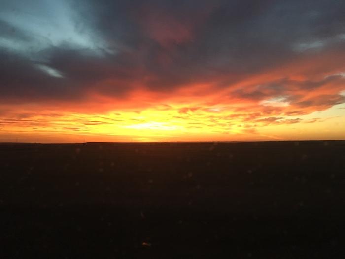 Dramatic orange and yellow sunrise in northwestern Nebraska.