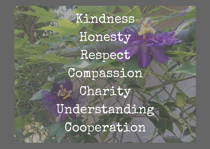 Flowers in background with text: Kindness, Honesty, Respect, Compassion, Charity, Understanding, Cooperation