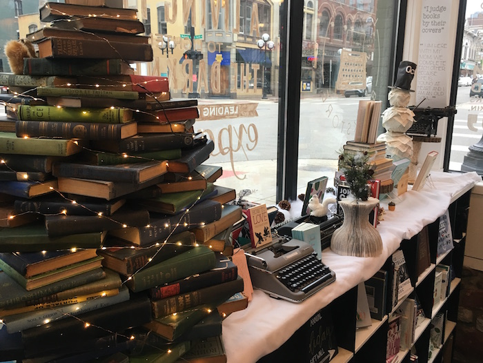 Christmas tree made out of books at Ann Arbor book store Literati