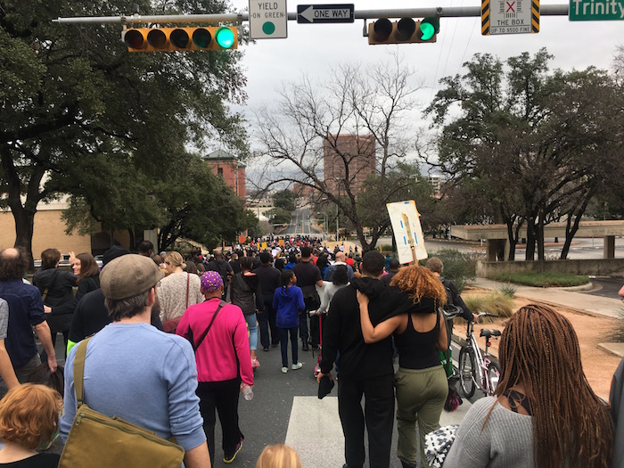 People participating in Austin's MLK Day March toward Huston-Tillotson University.