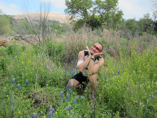 Matt Bush posed in bluebonnets at Enchanted Rock in Texas