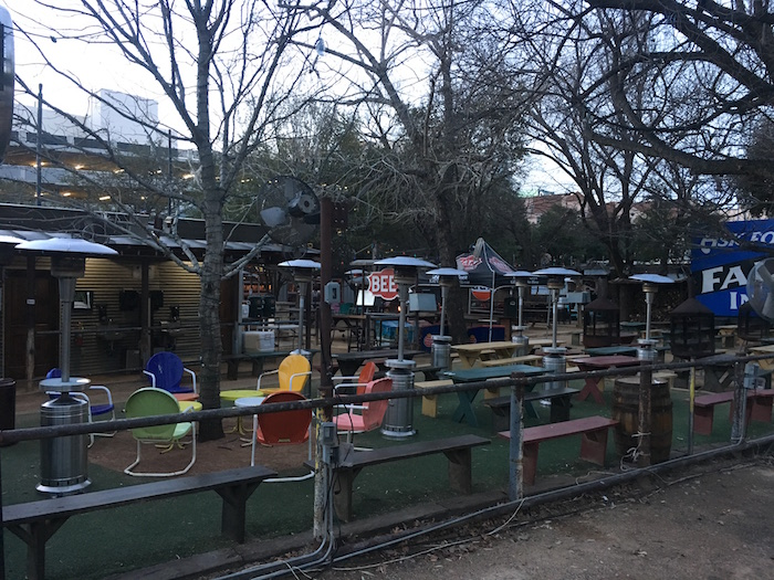 Outdoor tables at Katy Trails Icehouse in downtown Dallas