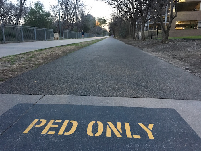 Pedestrian only pathway at Dallas' Katy Trail running next to concrete bike path