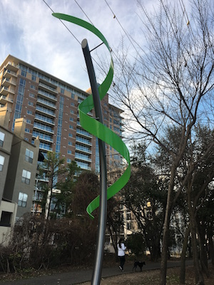 Green metal sculpture on Katy Trail in Dallas