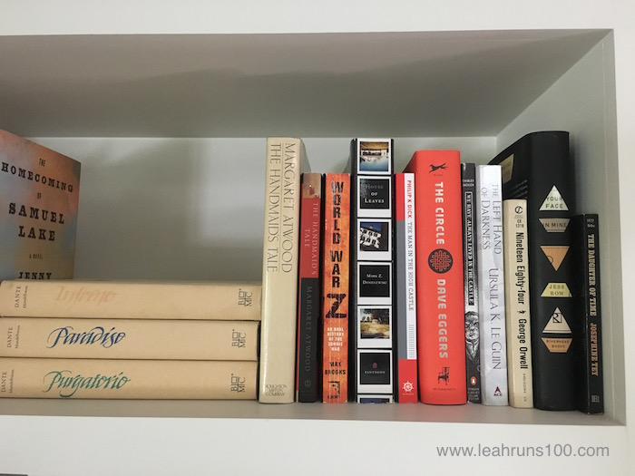 Shelf with copies of The Handmaid's Tale by Margaret Atwood and other books.