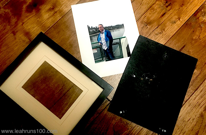 Disassembled picture frame with mat and photo for family Birthday Wall.