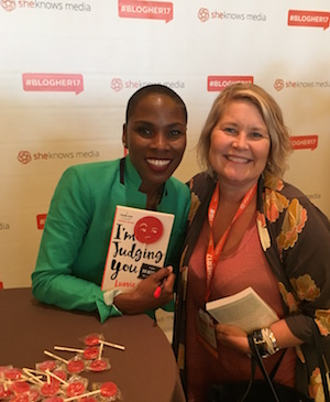 Luvvie Ajayi holds her autographed book with Leah Nyfeler at BlogHer