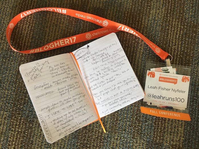 Badge and lanyard from BlogHer 2017 and book with notes
