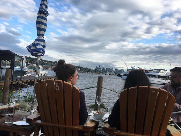 View of downtown Seattle across Union Lake from deck chairs at Westward.