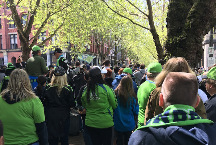 People wearing Seattle Sounders colors in the March to the Match from Occidental Park in Seattle.