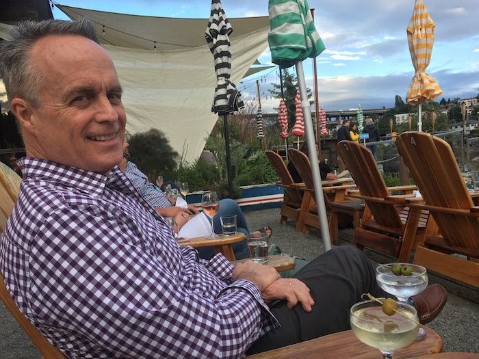 Enjoying happy hour in outdoors chairs at Westward in Seattle